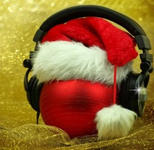 34457604 - christmas ball with headphones in glittering background